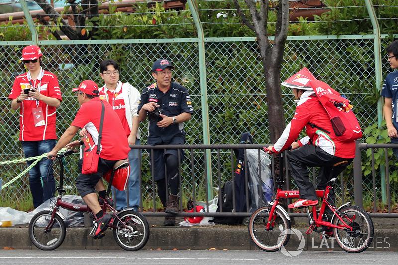 Ferrari fans on bikes
