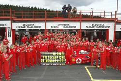 Michael Schumacher, Ferrari F2004 celebrates with the Ferrari team after winning his 7th world championship