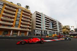Sebastian Vettel, Ferrari SF71H, leads Lewis Hamilton, Mercedes AMG F1 W09, Kimi Raikkonen, Ferrari SF71H and Valtteri Bottas, Mercedes AMG F1 W09