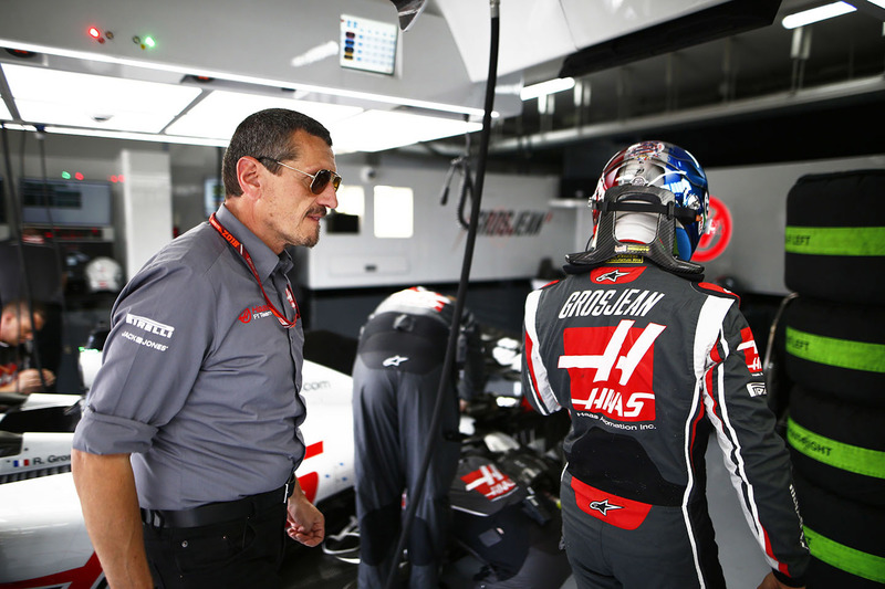 Guenther Steiner, Team Principal, Haas F1, and Romain Grosjean, Haas F1 Team