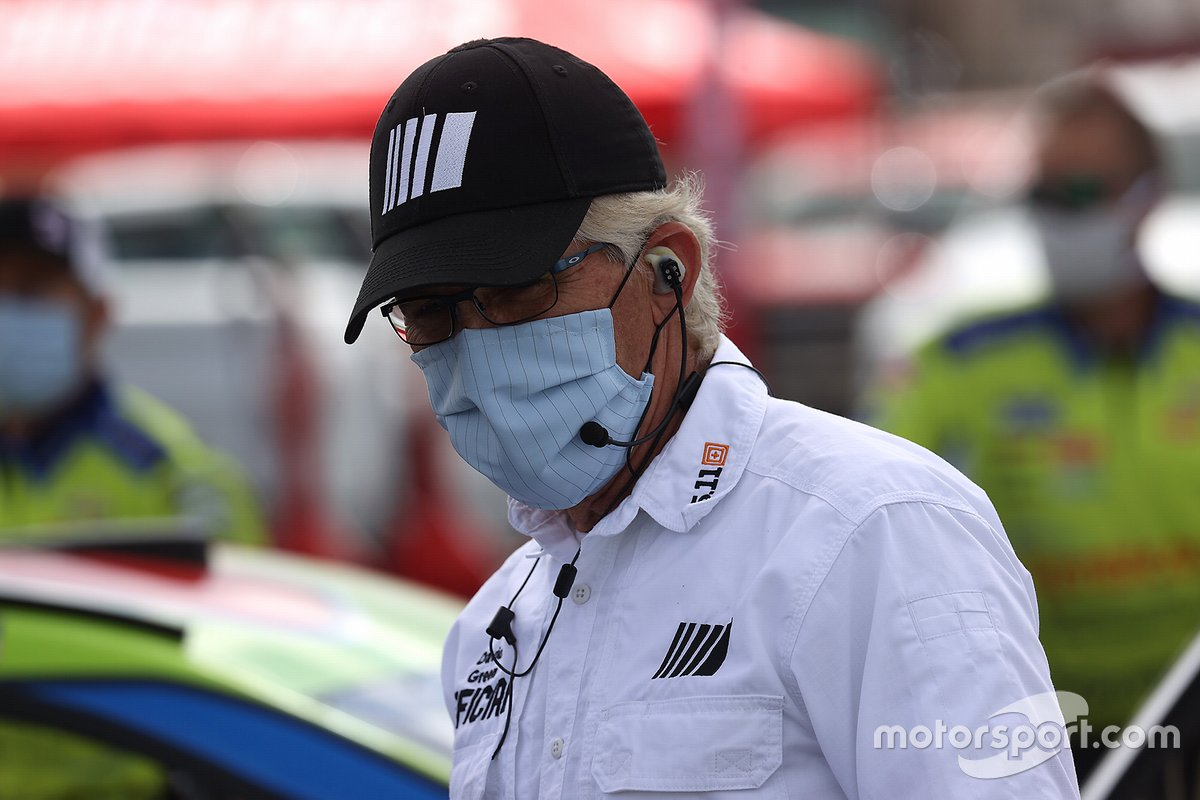 NASCAR official with a mask