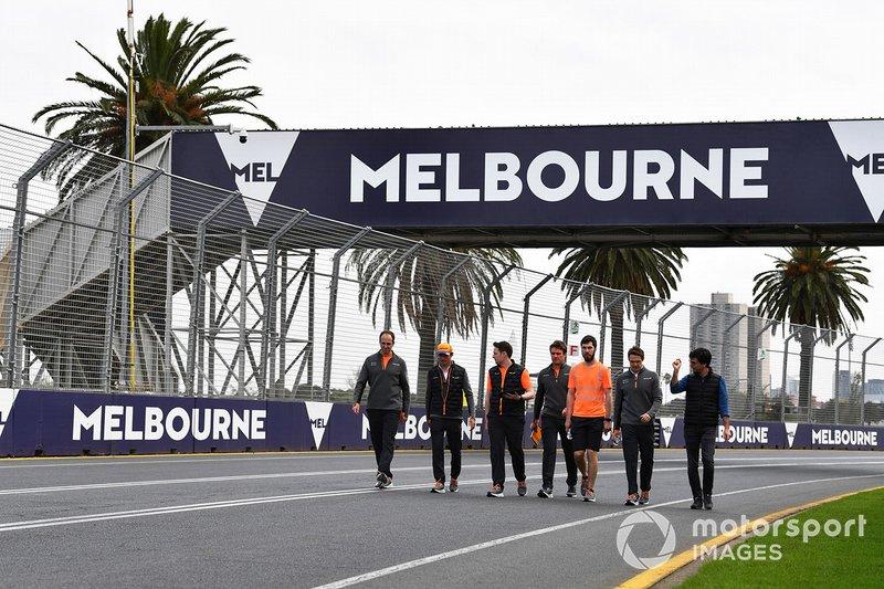 Charles Leclerc, Ferrari, walks the track with his team