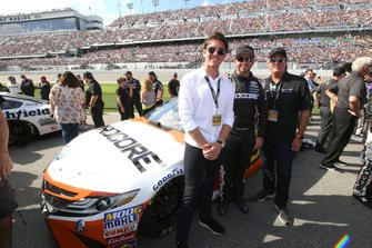 Matt DiBenedetto, Leavine Family Racing, Toyota Camry Procore and guest.