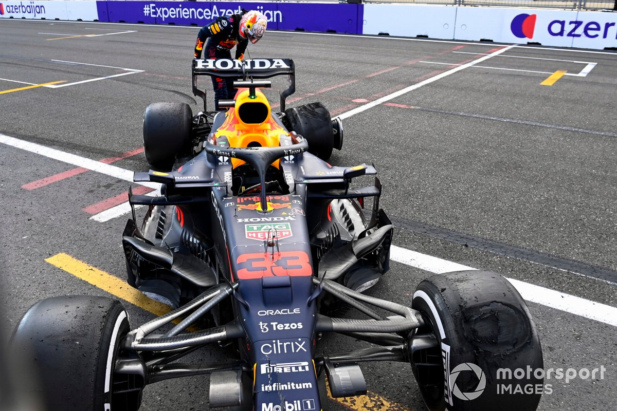 Max Verstappen, Red Bull Racing RB16B looking at the tyre after retiring from the race