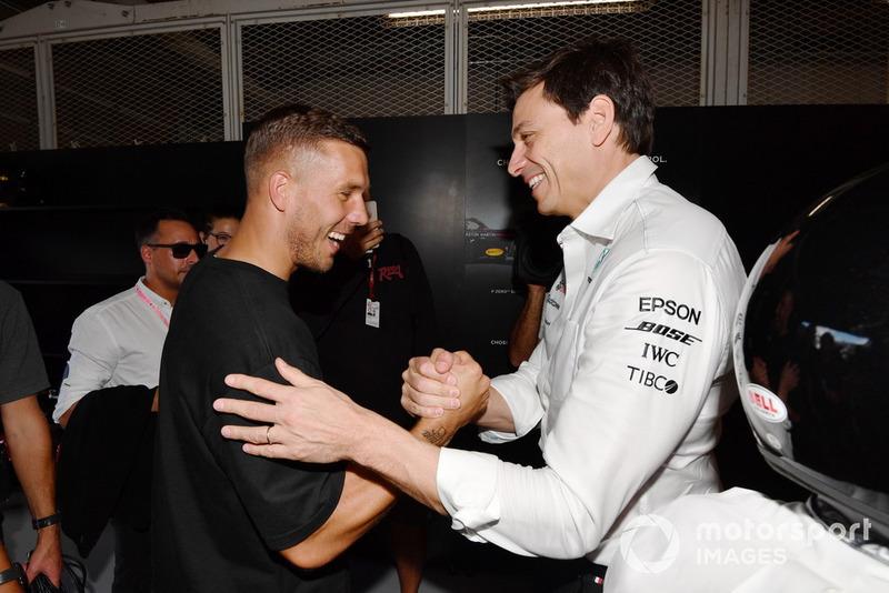 Lukas Podolski, Footballer and Toto Wolff, Mercedes AMG F1 Director of Motorsport