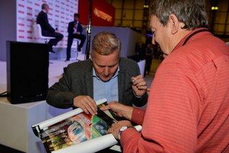 Johnny Herbert signs autographs