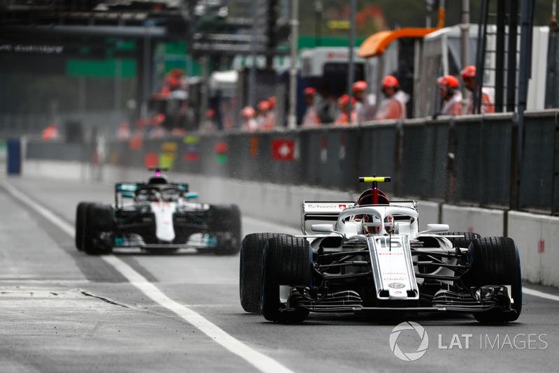 Charles Leclerc, Sauber C37, leads Lewis Hamilton, Mercedes AMG F1 W09