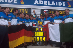 Michael Schumacher celebrates becoming World Champion with Flavio Briatore, Tom Walkinshaw and the rest of the Benetton team