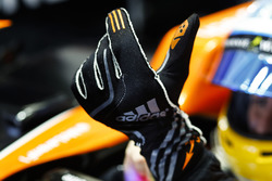 Fernando Alonso, McLaren, pulls on his gloves
