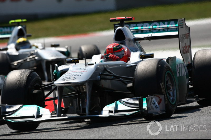 Michael Schumacher, Mercedes GP W02, leads Nico Rosberg, Mercedes GP W02