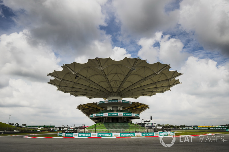 A covered grandstand at the final corner
