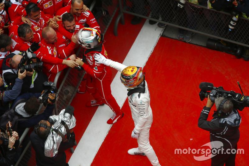 Winner Lewis Hamilton, Mercedes AMG, greets Sebastian Vettel, Ferrari, in parc ferme