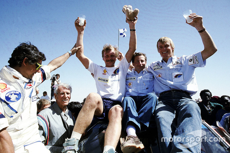 Winner Juha Kankkunen, Peugeot team director Jean Todt, Ari Vatanen