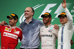 The podium (L to R): Sebastian Vettel, Ferrari, second; Lewis Hamilton, Mercedes AMG F1, race winner