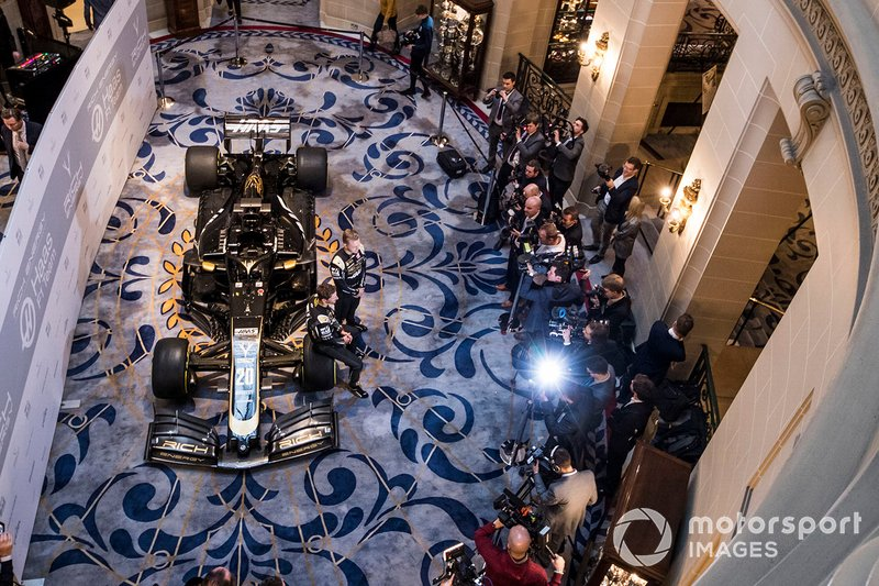 Romain Grosjean, Haas F1 Team and Kevin Magnussen, Haas F1 Team stand for photographs in front of the the new 2019 Haas livery on the Haas F1 Team VF-18