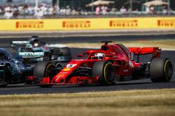 Sebastian Vettel, Ferrari SF71H, battles with Valtteri Bottas, Mercedes AMG F1 W09