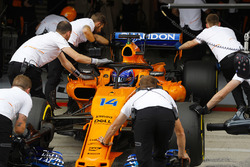 Fernando Alonso, McLaren MCL33, is returned to the McLaren garage