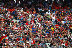 A huge crowd in a grandstand