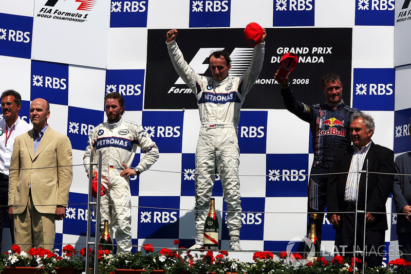 The podium: Nick Heidfeld, BMW Sauber F1, second; Robert Kubica, BMW Sauber F1, race winner; David Coulthard, Red Bull Racing, third