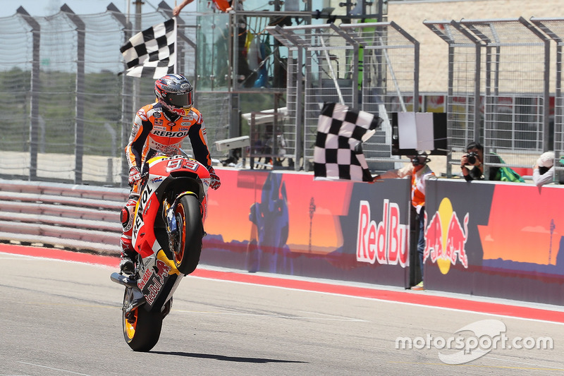 Marc Marquez, Repsol Honda Team, takes the checkered flag