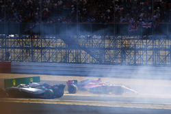 Sergio Perez, Force India VJM11, crashes into a advertising board, as Sergey Sirotkin, Williams FW41, passes by
