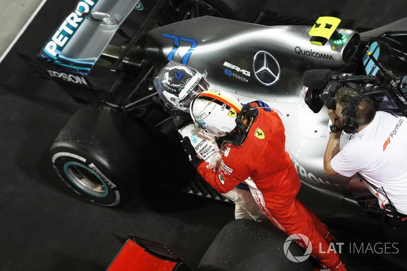 Valtteri Bottas, Mercedes AMG F1, 2nd position, congratulates Sebastian Vettel, Ferrari, 1st positio