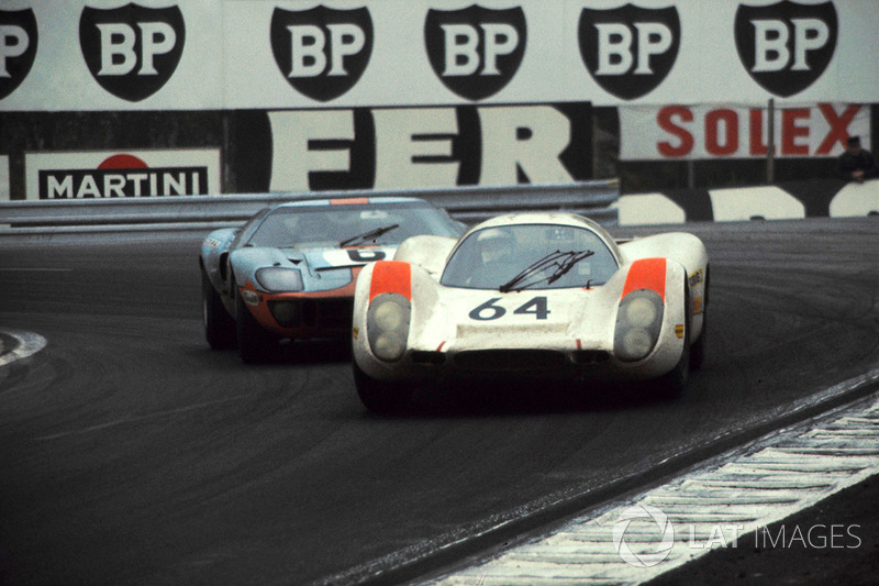Hans Herrmann, Porsche 908 ahead of Jacky Ickx, John Wyer Automotive Ford GT40