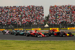 Max Verstappen, Red Bull Racing RB13 leads at the start of the race and collides with Sebastian Vettel, Ferrari SF70H