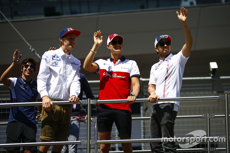 Brendon Hartley, Toro Rosso, Marcus Ericsson, Sauber, and Sergio Perez, Force India, in the drivers parade