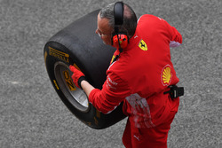 Ferrari mechanic with Pirelli tyre