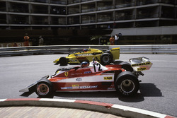 Gilles Villeneuve, Ferrari 312T3 passes Emerson Fittipaldi, Copersucar F5A-Ford