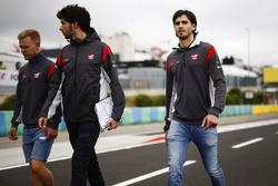 Antonio Giovinazzi, Haas F1 Team test driver, Kevin Magnussen, Haas F1 Team, conduct a track walk