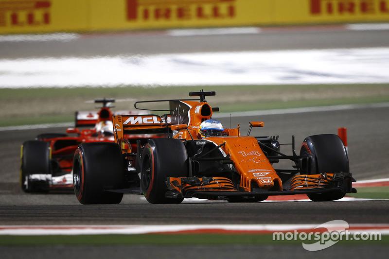 Fernando Alonso, McLaren MCL32, leads Sebastian Vettel, Ferrari SF70H