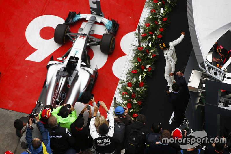 Lewis Hamilton, Mercedes AMG F1 W08, celebrates on the podium ahead of Sebastian Vettel, Ferrari SF70H and Max Verstappen, Red Bull Racing RB13