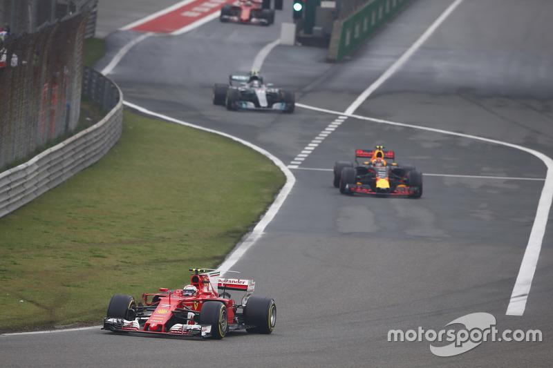 Kimi Raikkonen, Ferrari SF70H, leads Max Verstappen, Red Bull Racing RB13, and Valtteri Bottas, Merc