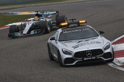 The Safety Car leads Lewis Hamilton, Mercedes AMG F1 W08