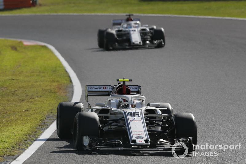 Charles Leclerc, Sauber C37 leads Marcus Ericsson, Sauber C37