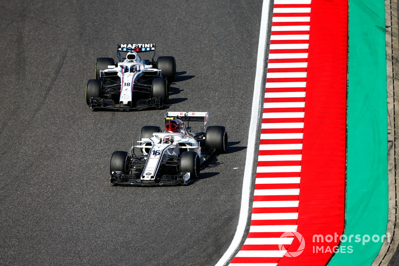 Charles Leclerc, Sauber C37, leads Lance Stroll, Williams FW41