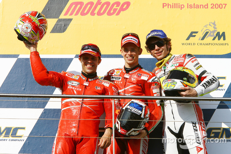 Podium: second place Loris Capirossi, Ducati; Race winner Casey Stoner; third place Valentino Rossi