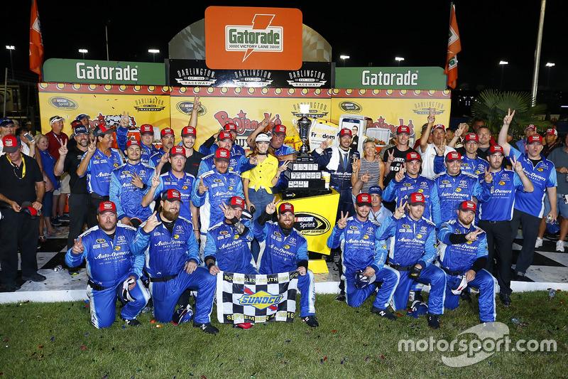 Race winner Martin Truex Jr., Furniture Row Racing Toyota with his crew