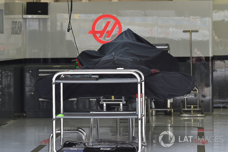 Haas F1 Team VF-18 under covers in the garage