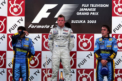 The podium: Giancarlo Fisichella, Renault, second; Kimi Raikkonen, McLaren, race winner; Fernando Al