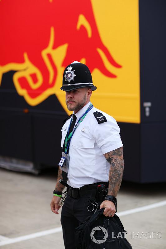 A heavily tattoed policeman