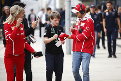 Sebastian Vettel, Ferrari, signs an autograph for a young fan