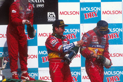 Podium: race winner Jean Alesi, Ferrari, second place Rubens Barrichello, Jordan, third place Eddie Irvine, Jordan