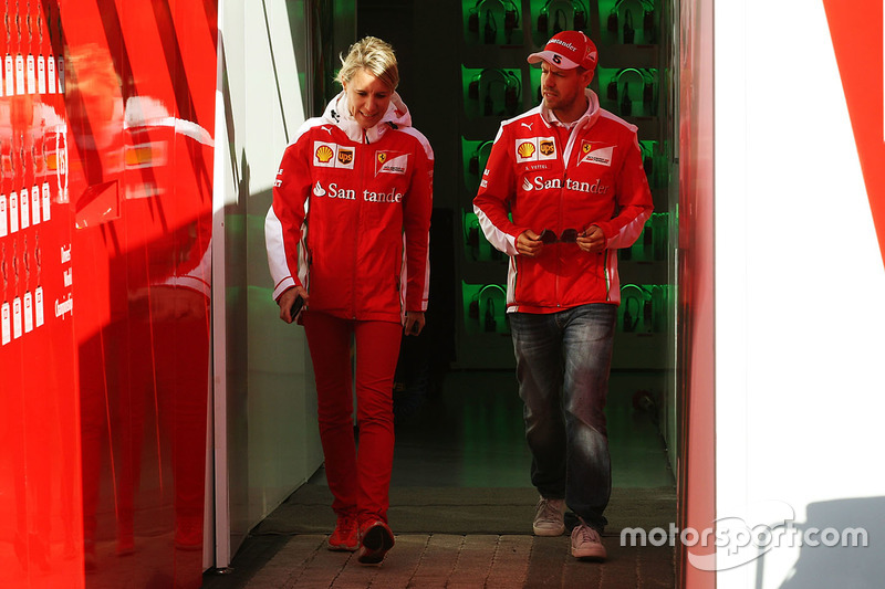 Sebastian Vettel, Ferrari with Britta Roeske, Ferrari Press Officer
