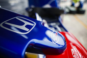 A Toro Rosso logo on a nose cone in the pit lane
