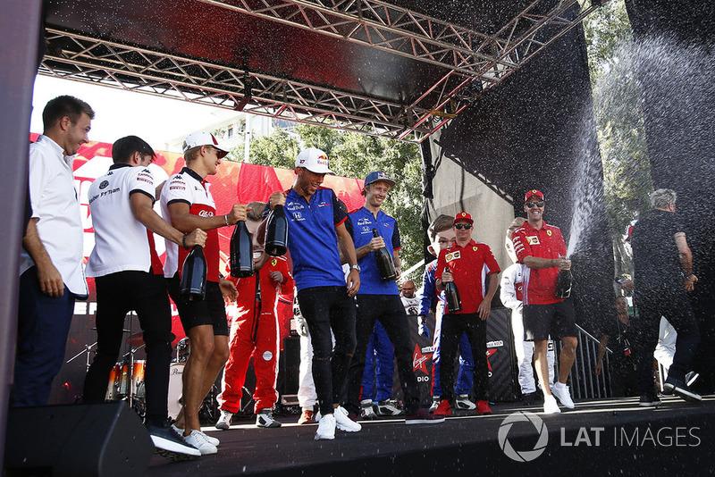 Charles Leclerc, Sauber, Marcus Ericsson, Sauber, Pierre Gasly, Scuderia Toro Rosso Toro Rosso, Brendon Hartley, Scuderia Toro Rosso and Sebastian Vettel, Ferrari spray the champagne on stage