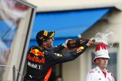 Daniel Ricciardo, Red Bull Racing, sprays champagne on the podium