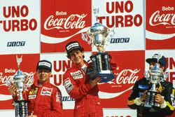 Podium: race winner Alain Prost, McLaren, second placed Michele Alboreto, Ferrari, third placed Elio De Angelis, Lotus